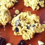 white chocolate apricot cookies surrounded by dried cherries and white chocolate chips