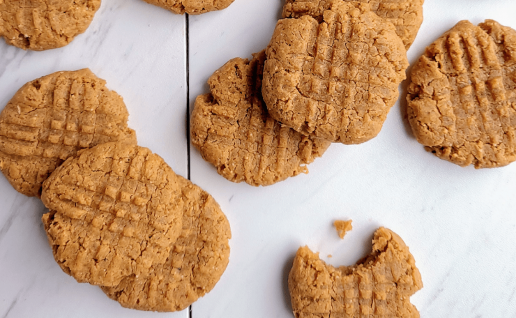 stacks of healthy peanut butter cookies, one with a bite taken out