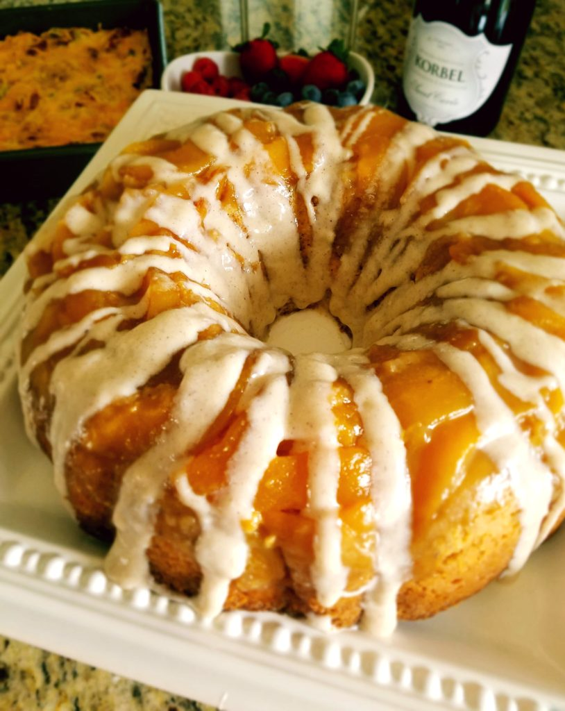 Peach Upside Down Cake. Luscious peaches sit atop dense cinnamon cream cheese cake perfect for brunch or dessert.