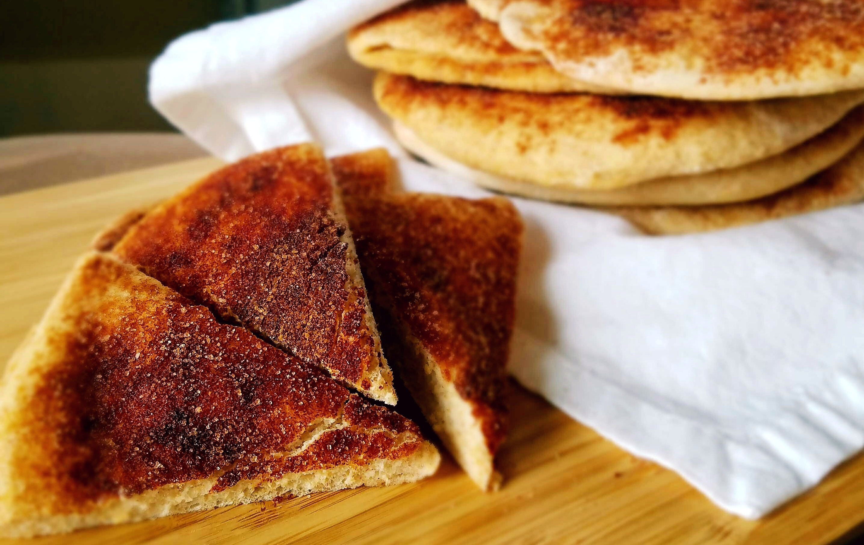 Homemade cinnamon sugar pita bread. Is that anything better than a fresh baked pita that's soft, fluffy and covered it sweet cinnamon sugar?
