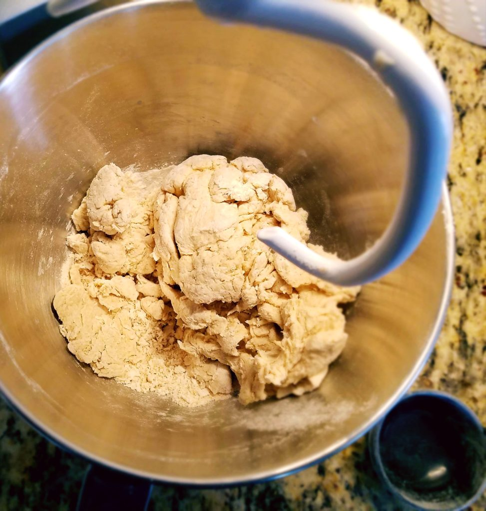 Shaggy pita bread dough. A dough hook helps to make the bread dough come together much easier than by hand.