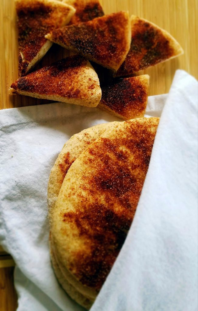Homemade cinnamon sugar pita bread. Made with whole wheat and natural sugar, these pitas won't last long around your friends.