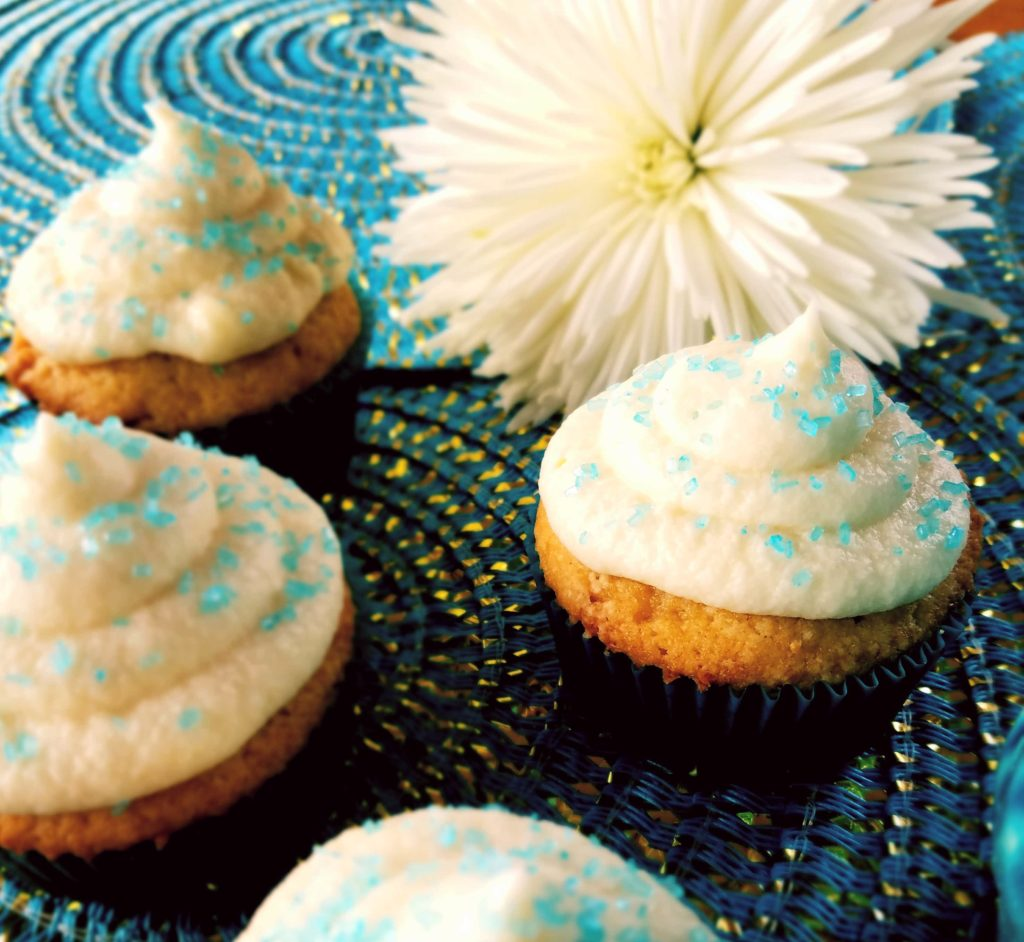 From scratch, easy vanilla cupcakes are moist and topped with an easy buttercream frosting.