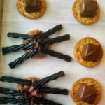 Cut up licorice to make legs for spooky spiders. An easy treat to make for a Halloween party with only 5 ingredients.