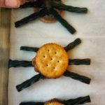 Mini Snickers help to make spooky spiders. They're easy to make, only have 5 ingredients, and are perfect for a Halloween party treat.