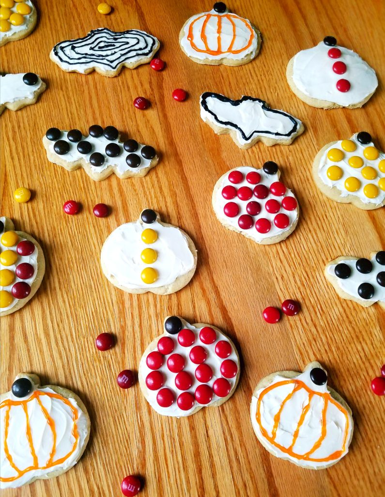 How to make Pumpkin spice sugar cookies are the perfect cut out cookie to make with your kids for Fall or Halloween. Top with cream cheese frosting and M&Ms for decorations.