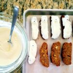 Dip gluten free biscotti in melted white chocolate for a fun Halloween treat.