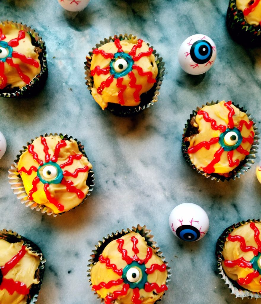 Spooky Halloween eyeball chocolate cupcakes are both gluten free and healthy. Made with pumpkin and garbanzo bean flour, these are a sweet treat you can feel good about on Halloween. #halloweentreats