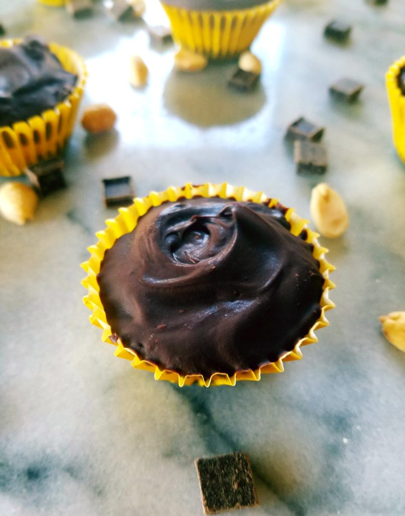 Healthy peanut butter cups are a perfect Reese's copy cat that only require 4 ingredients and 30 minutes to make. They're full of protein and healthy dark chocolate. Eat as a small dessert, or a pre or post workout snack.