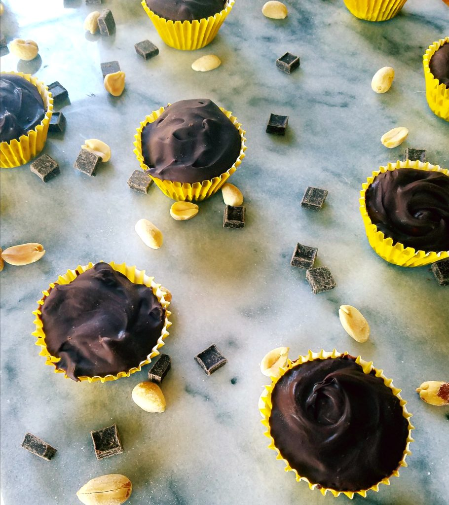 close up of healthy peanut butter cups on a marble surface