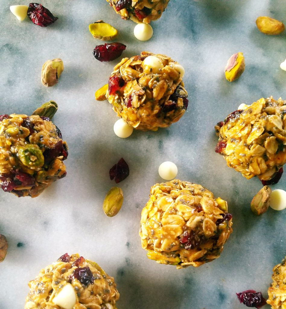 Cranberry pistachio energy bites are the perfect healthy treat to keep on hand during the crazy holiday season. They're easy and quick to put together and travel really well. #glutenfree #healthy #energy