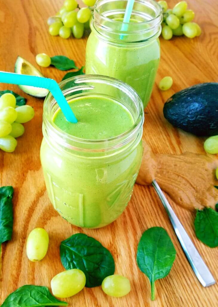 This morning power green smoothie will get your day started off on the right foot. With a combination of grapes, spinach, avocado and peanut butter, you'll get the best combination of fats and carbs all in one smoothie. #healthysmoothie #breakfastsmoothie #smoothie