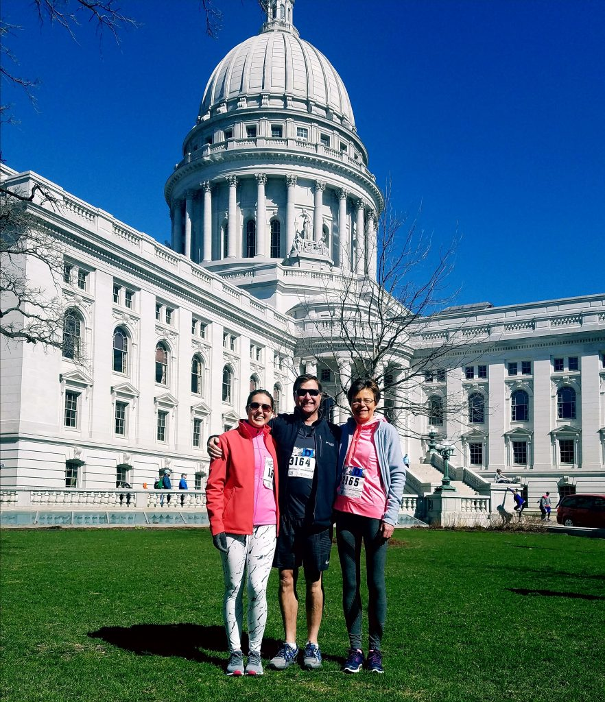 runners in front of the Madison state capital