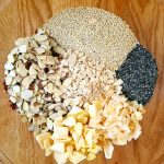 ingredients for mango coconut granola in a large bowl. Pre-mixed
