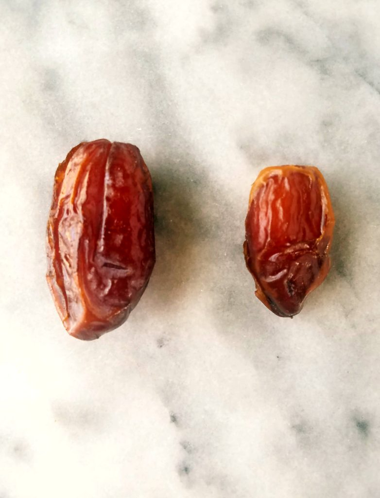 medjool date on the left, regular date on the right