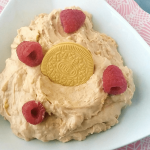 lemon raspberry fruit dip with a lemon Oreo thin and fresh raspberries