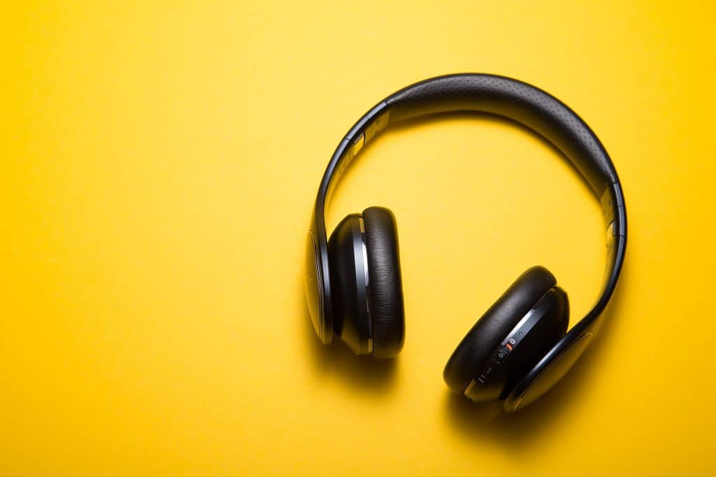 pair of headphones on a yellow background