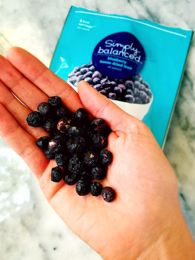 freeze dried blueberries in a hand