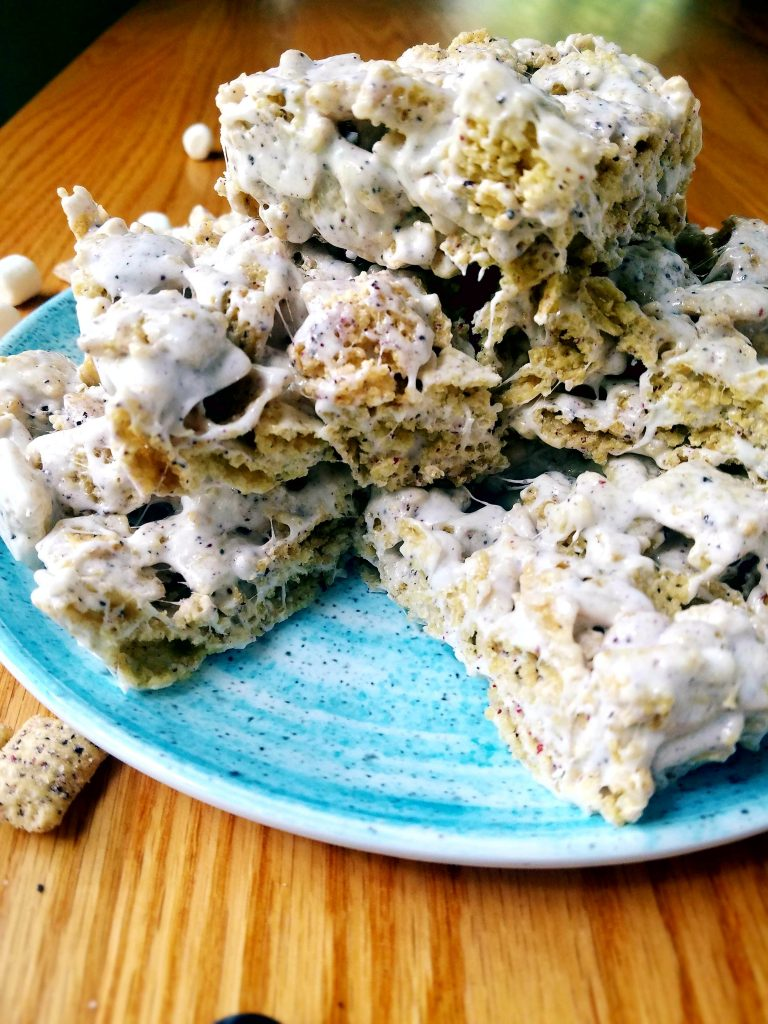 stack of blueberry chex vegan krispie treats on a blue plate