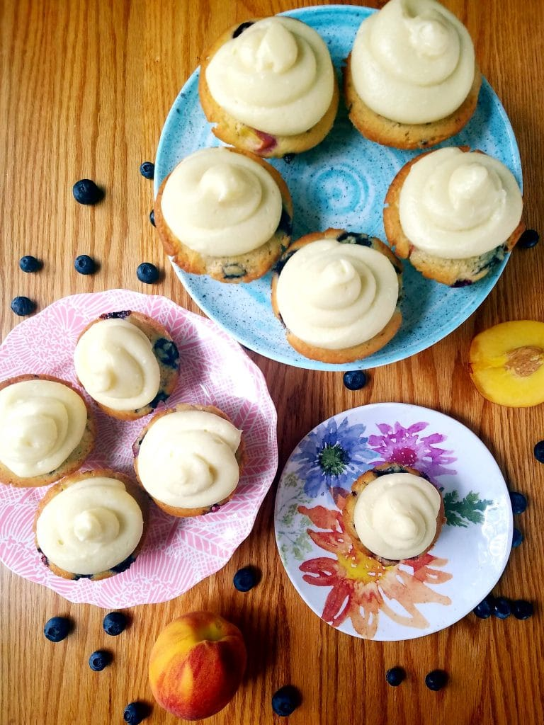 blueberry peach cupcakes on three different plates
