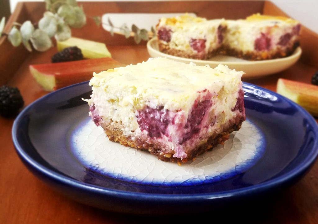 slices of gluten free rhubarb cheesecake bars on a plate