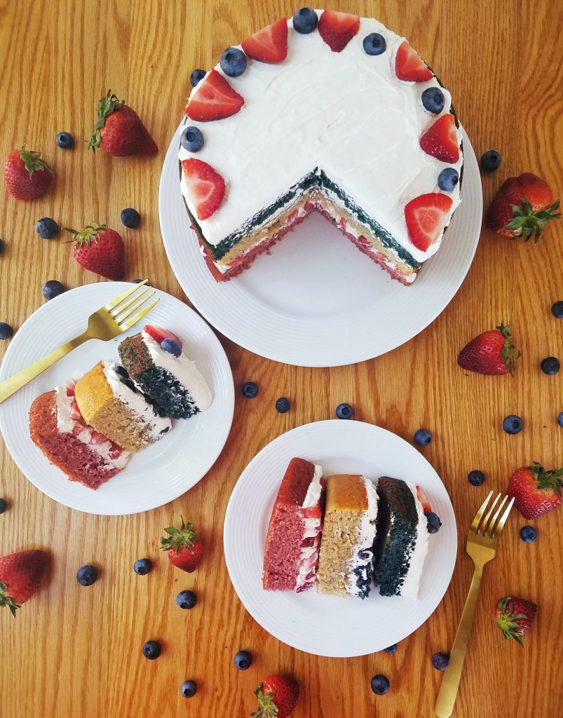 two slices of healthy berry layer cake on white plates