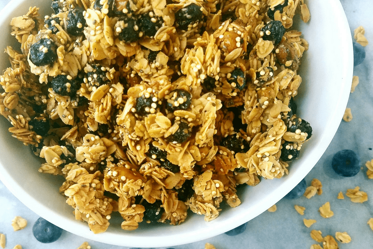 up close photo of blueberry pistachio granola in a bowl
