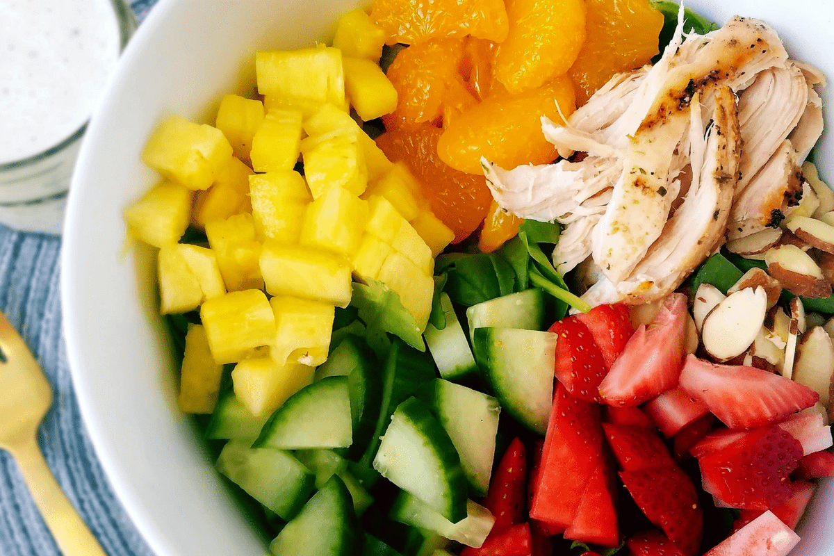 strawberry and chicken salad with cucumber, pineapple and mandarin oranges