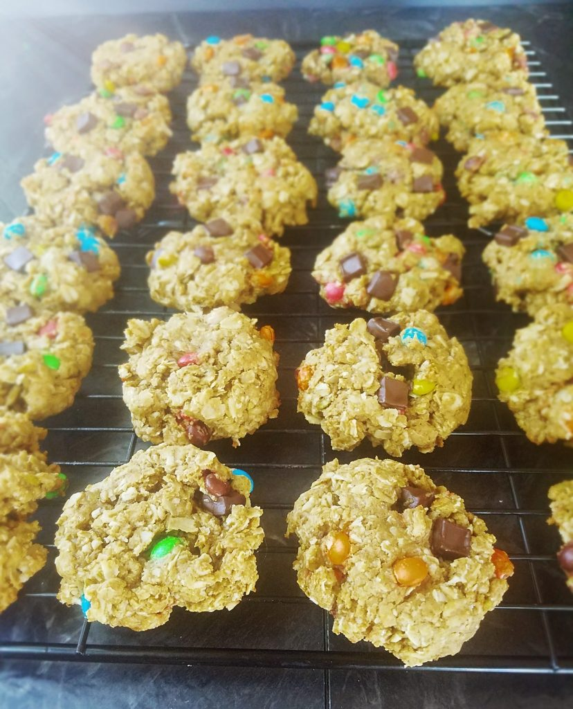 rows of healthy gluten free monster cookies on a baking rack