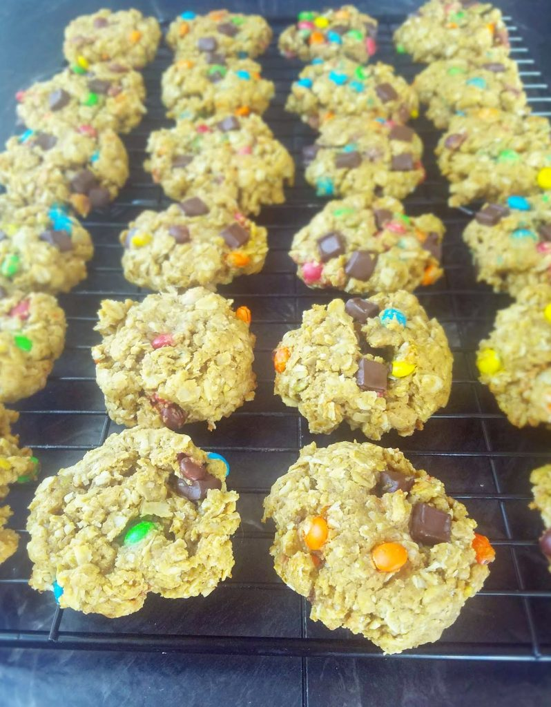 healthy monster cookies on a cookie rack