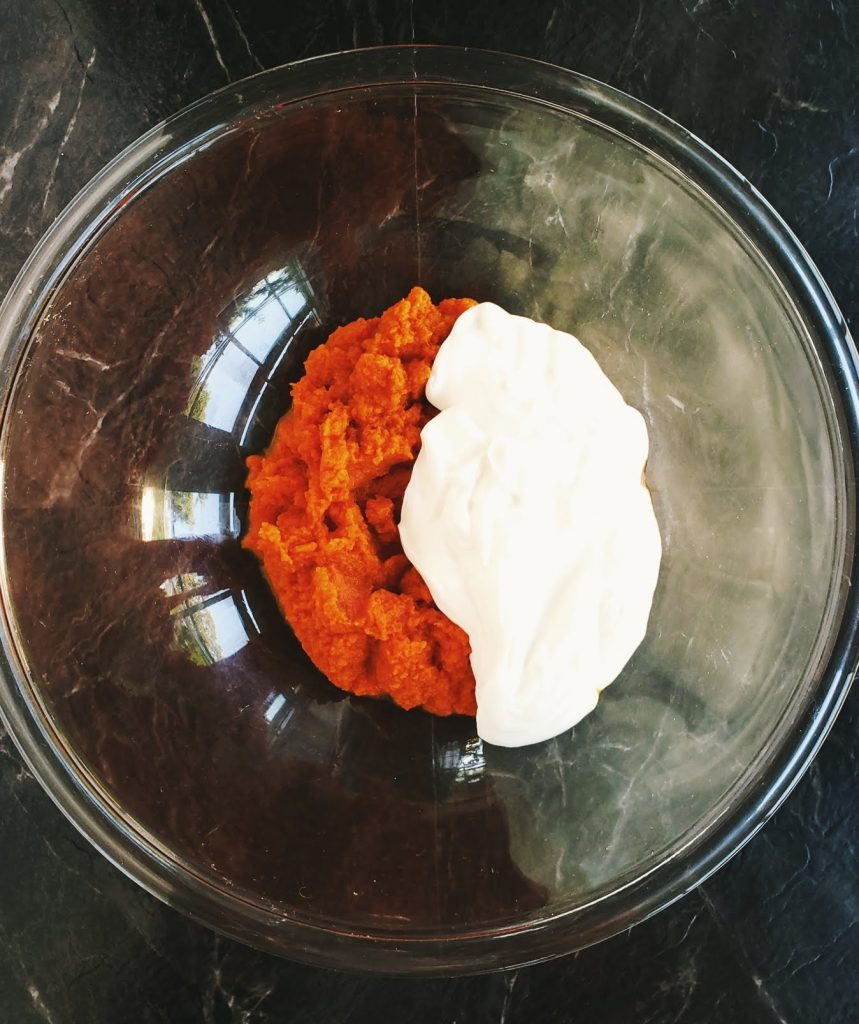pumpkin puree and greek yogurt in a clear bowl