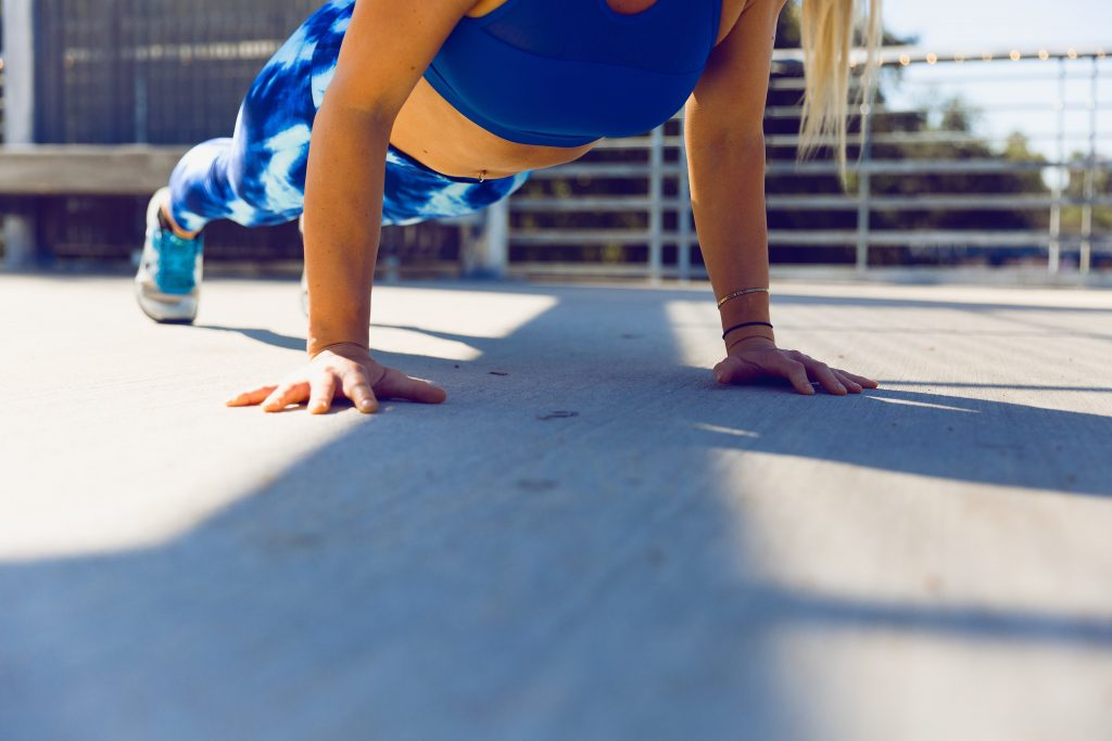woman about to do a pushup