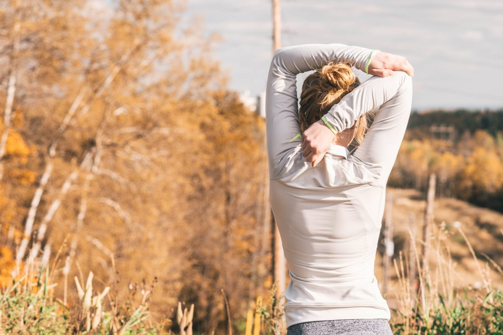 a woman stretching her arms