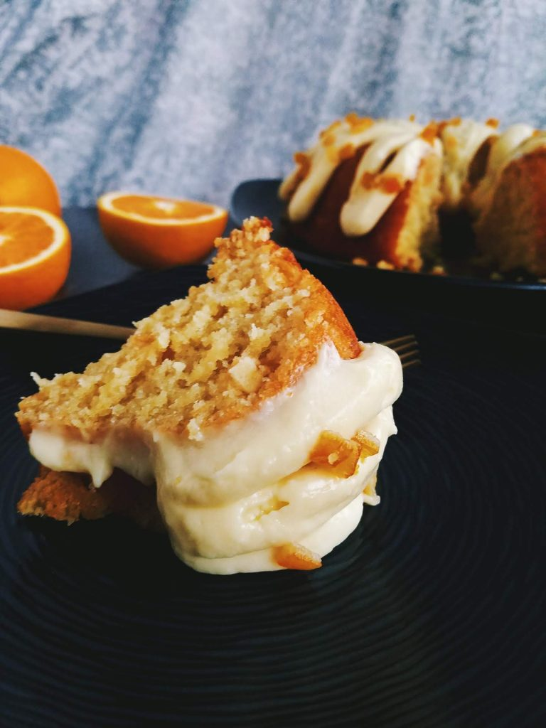 slice of orange cake out on a plate