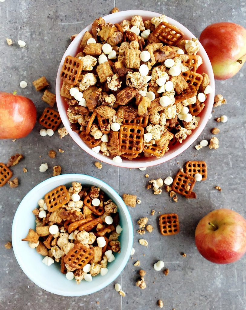 two bowls filled with apple pie snack mix
