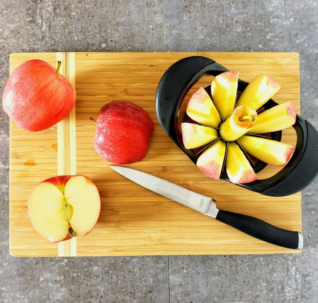 cut apples, sliced apples on a cutting board