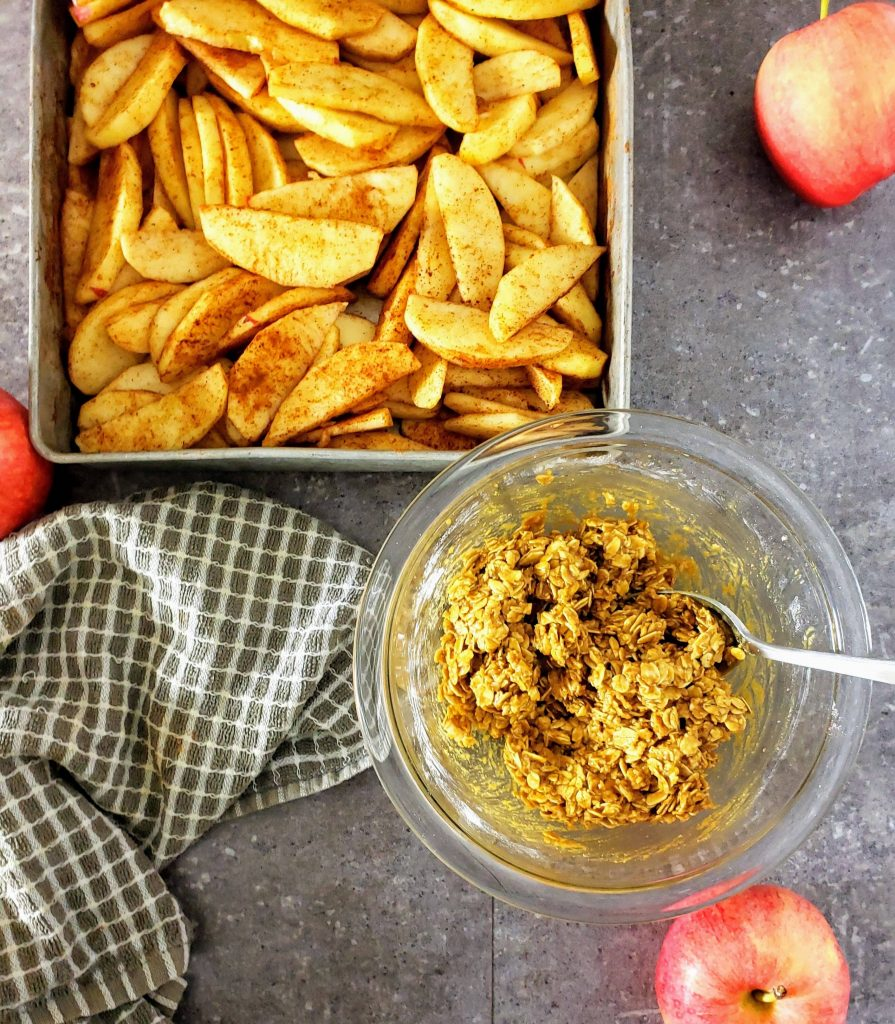 apples and crisp topping in a bowl before baking