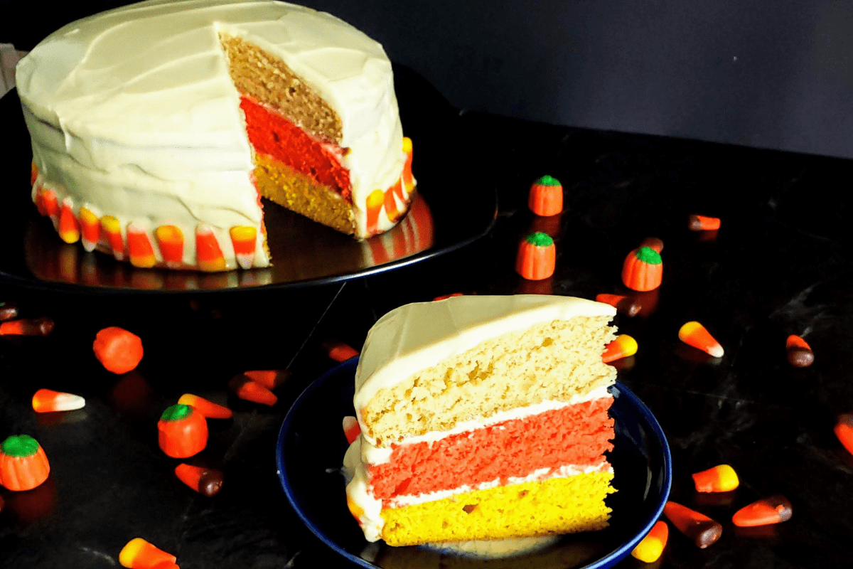 slice of candy corn cake with cake in the background