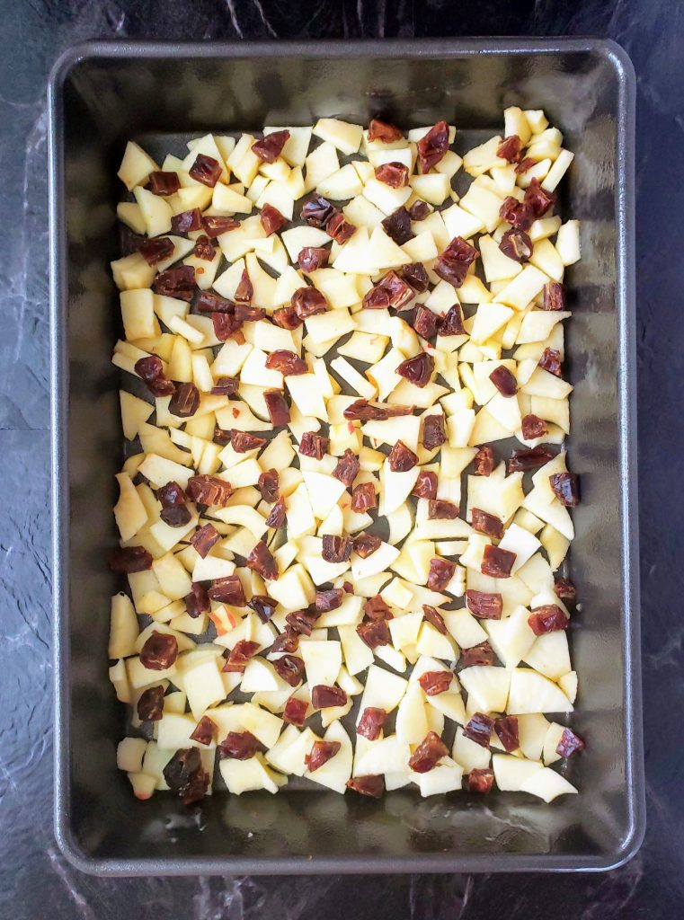 "diced fresh apples and dates in a 9"" x 13"" pan"