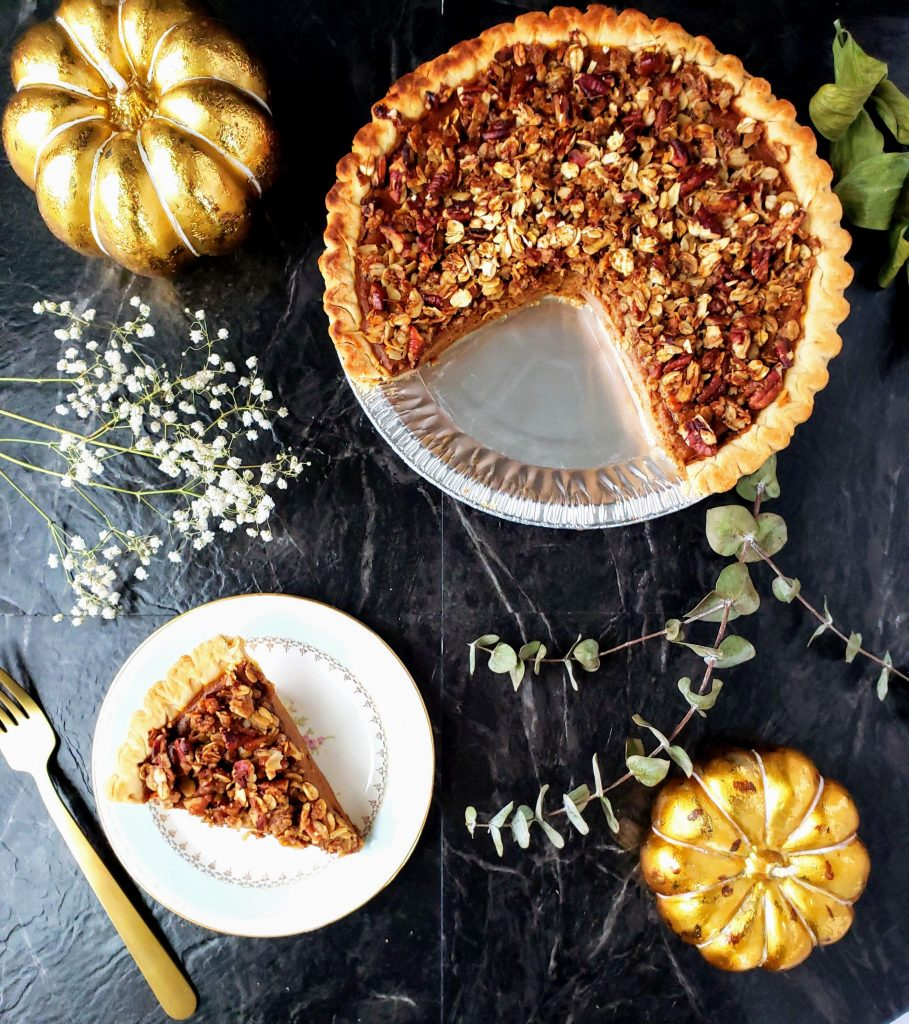 healthy pumpkin pie deluxe with a slice on a small plate