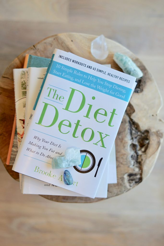 stack of detox cleanse books