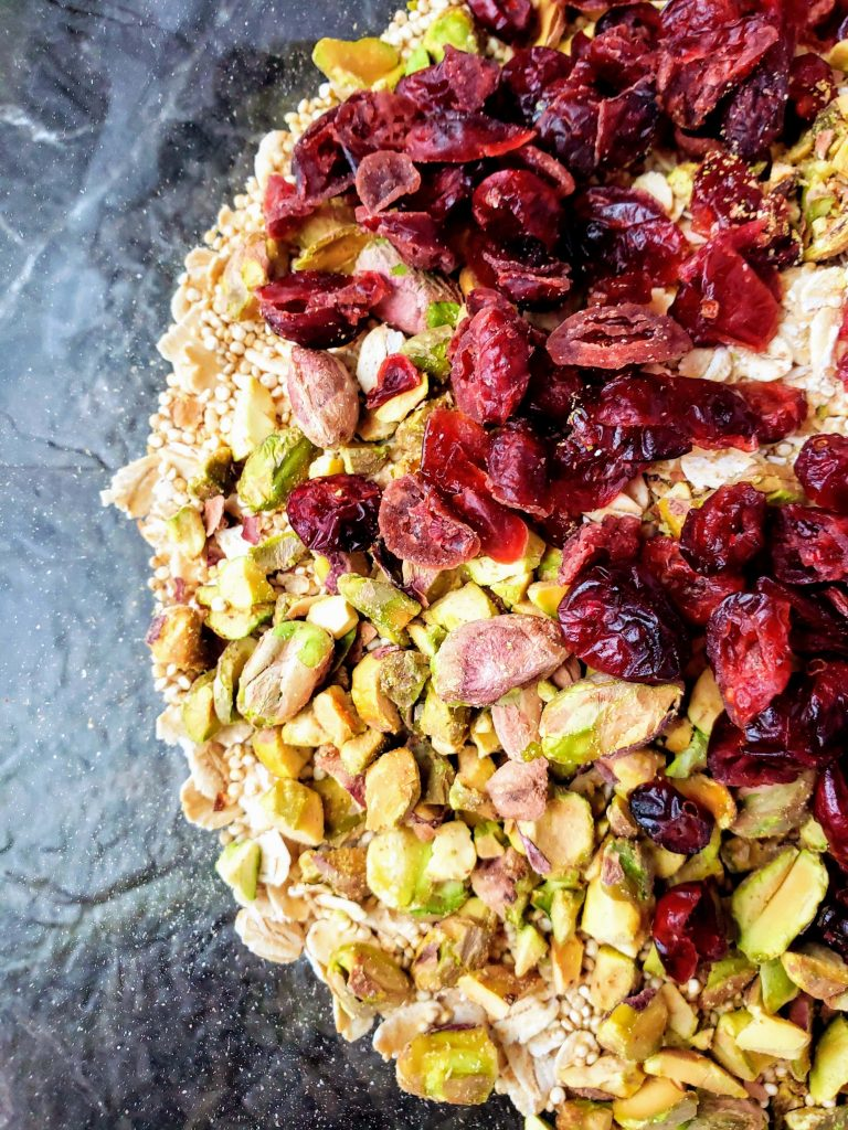 up close of dried cranberries, pistachios, quinoa and oats