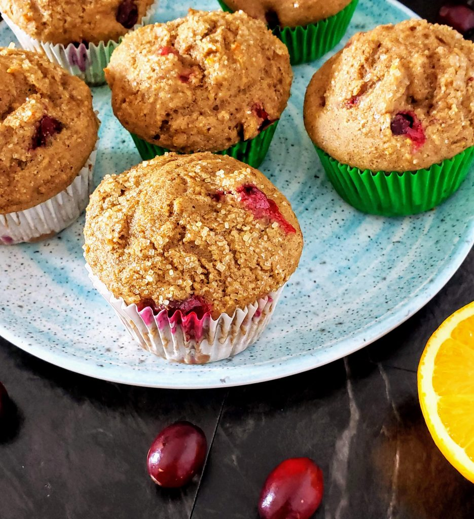 plate of healthy cranberry orange muffins