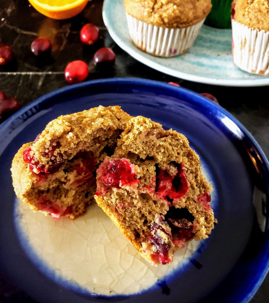 healthy cranberry orange muffin sliced open
