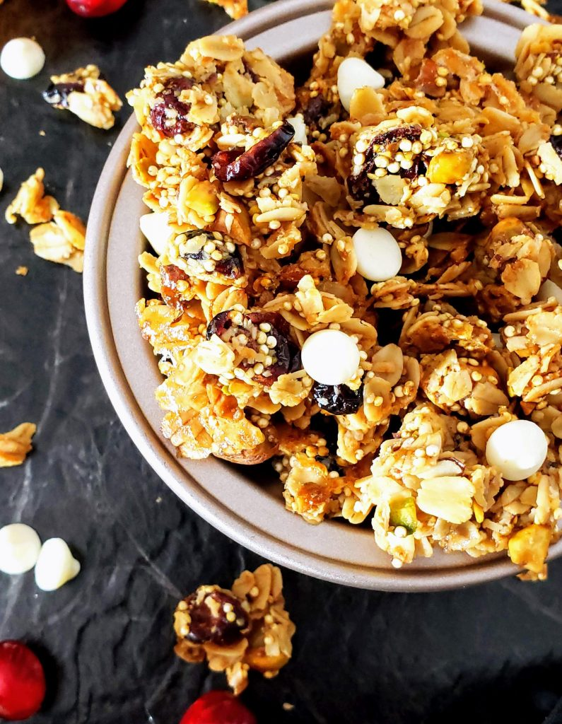 up close of healthy cranberry orange pistachio granola in a bowl