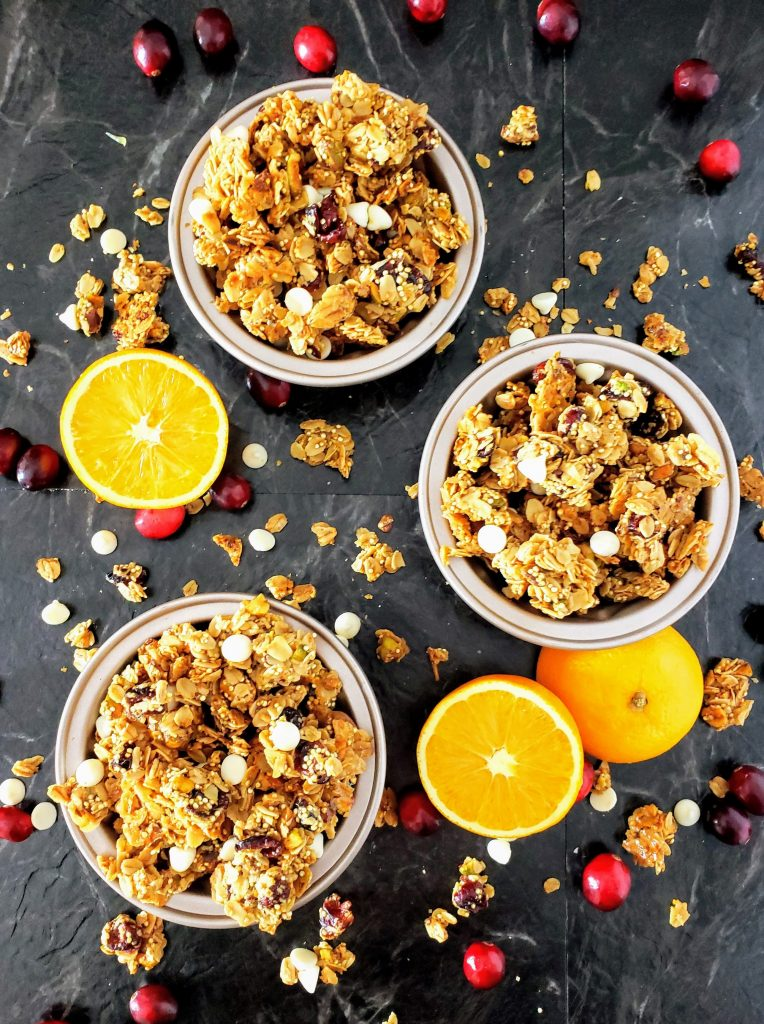 three bowls of cranberry orange pistachio granola