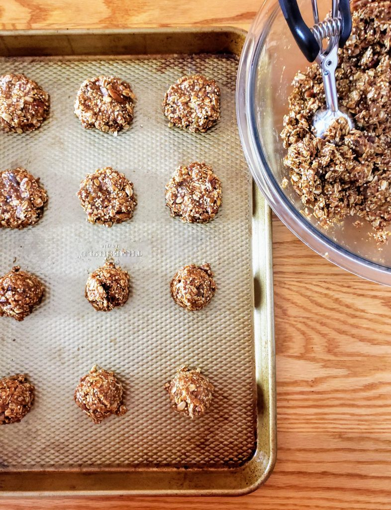 gluten free healthy breakfast cookies on a baking tray with a bowl of batter off to the right