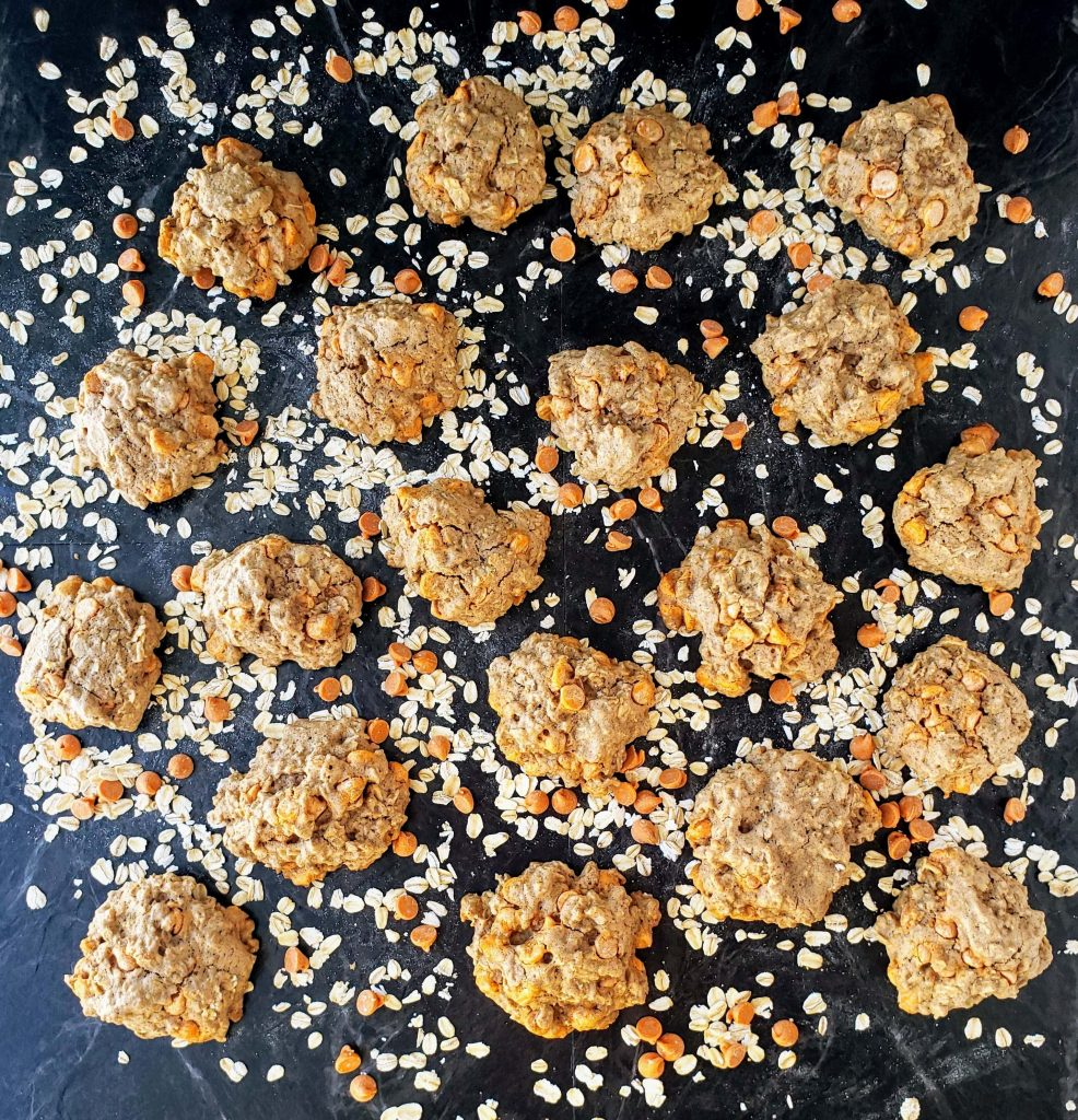 bourbon caramel oatmeal cookies surrounded by oatmeal and caramel chips