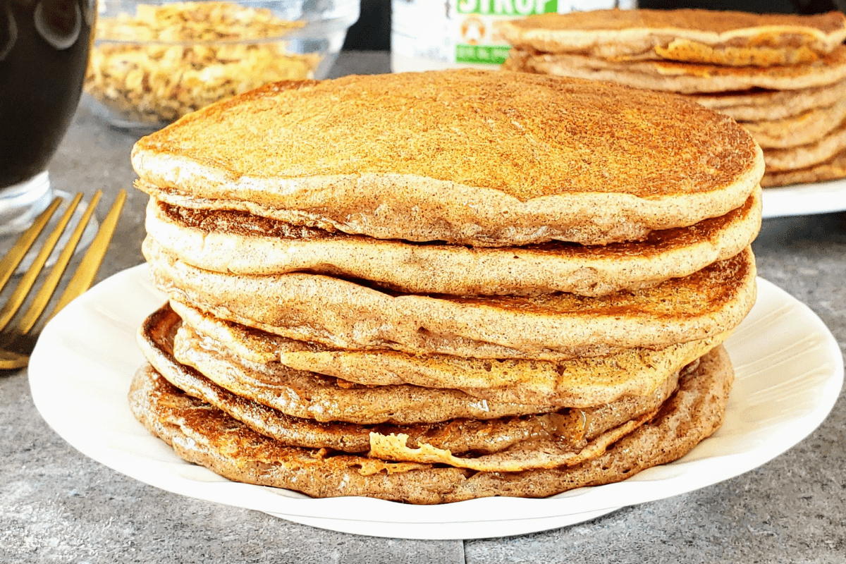 up close image of a stack of healthy cinnamon ricotta pancakes