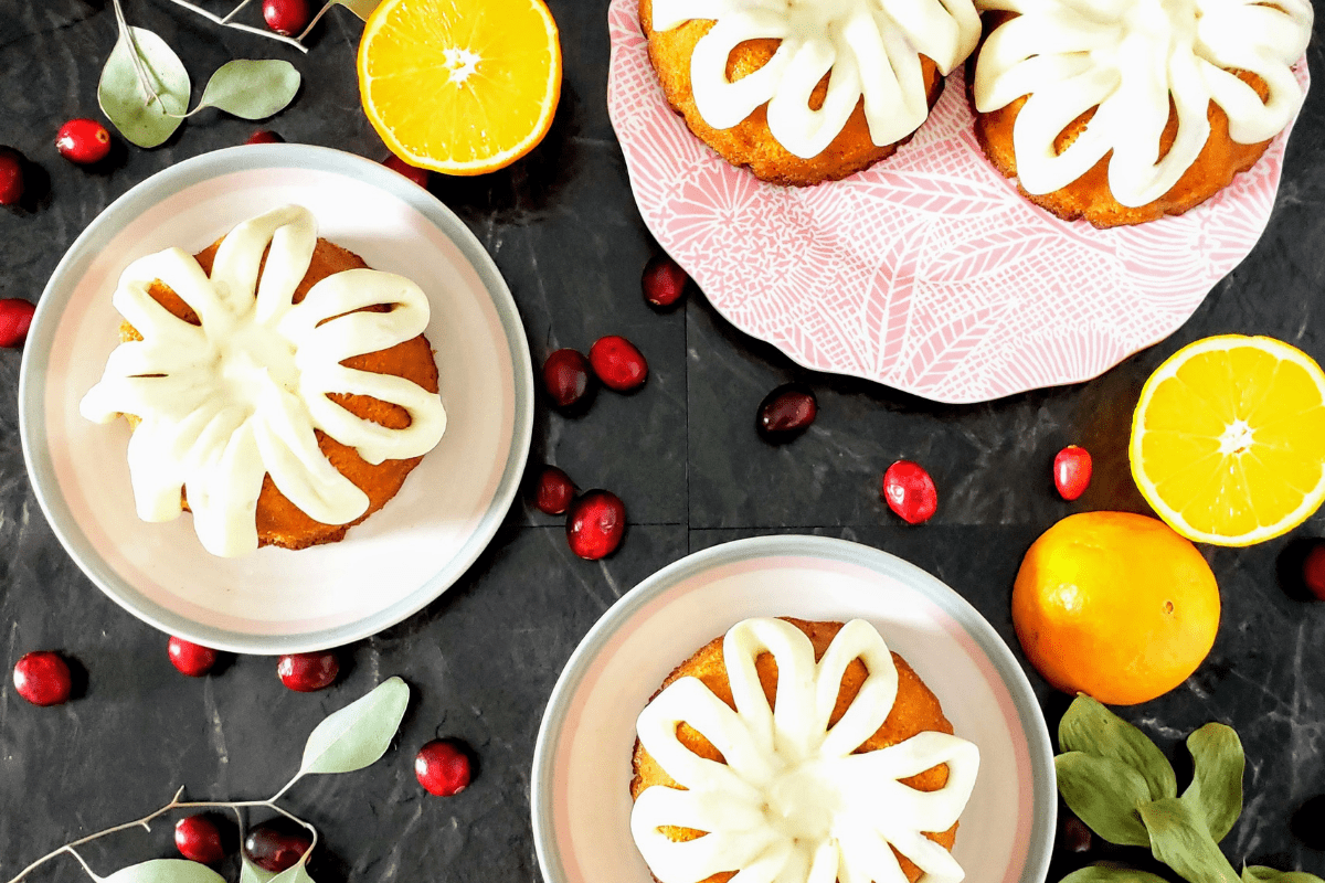 top down view of four mini cranberry orange bundt cakes